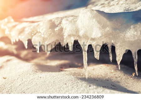 Winter ice on the lake. Macro image. Small depth of sharpness. Creative toning effect - stock photo