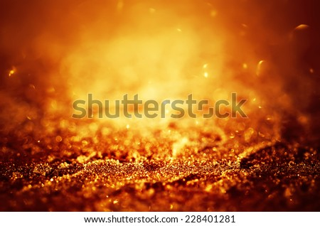 Winter iced glowing golden pattern with bokeh, holiday seasonal background - stock photo