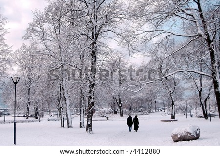 Winter in City Park. Couple in winter park. - stock photo