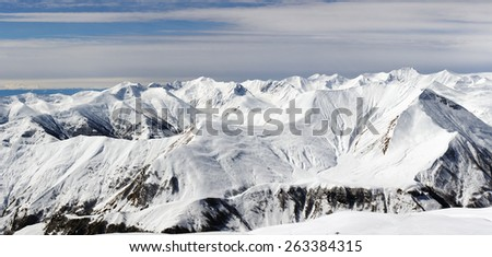 Winter in mountain range. Caucasus mountains panoramic view. - stock photo