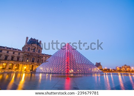 Winter in Paris, France - DEC 6, 2014: The Louvre Museum is one of the world's largest museums and a historic monument. A central landmark of Paris, France. - stock photo