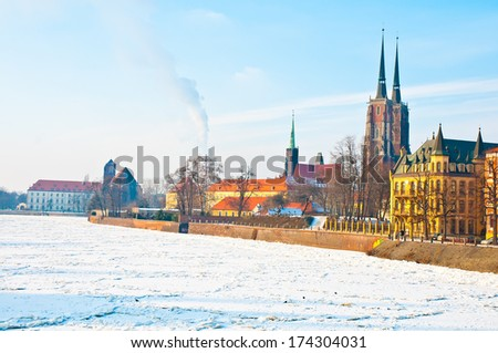 Winter in Poland. Frozen Odra river with old city in the background. Wroclaw, Poland - stock photo