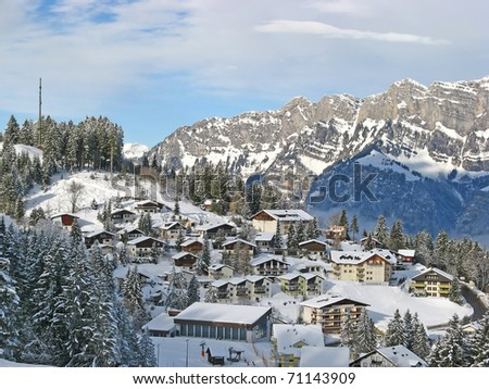 Winter in swiss alps (Flumserberg, St. Gallen, Switzerland) - stock photo