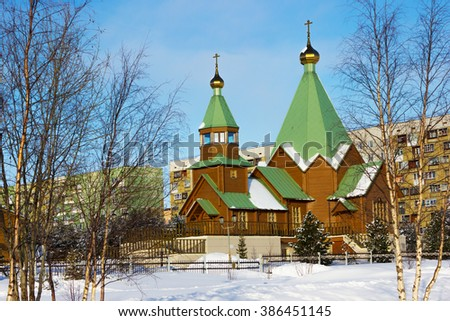 Winter in the city Polyarnye Zori, Russia, a new temple - stock photo