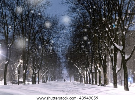 Winter in the evening park in the city - stock photo