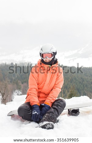 Winter in the mountains, emotional girl with a snowboard - stock photo