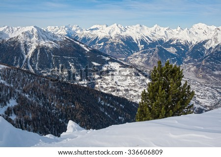 Winter in the Swiss Alps, 4 valleys. View of snow covered valley and mountain ranges. - stock photo