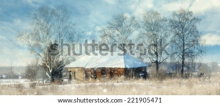 Winter in the village, wooden house - stock photo