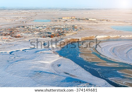 Winter industrial landscape. Oil and gas background.