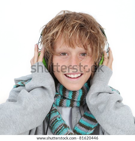 winter kid listening to music with headphones - stock photo