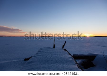 Winter lake with wharf - stock photo