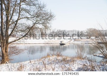 Winter landscape and a river / Winter time
