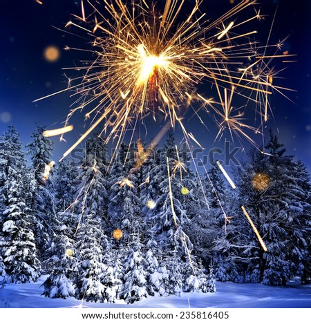 winter landscape and sparkler - stock photo