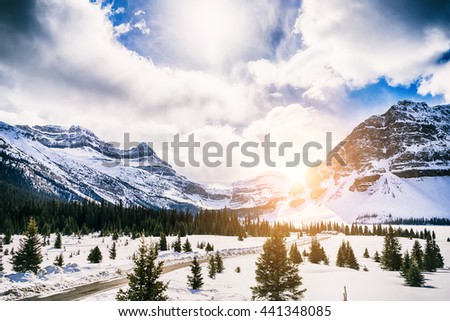 Winter landscape. Canadian Rocky Mountains and frozen Bow Lake, Canada - stock photo