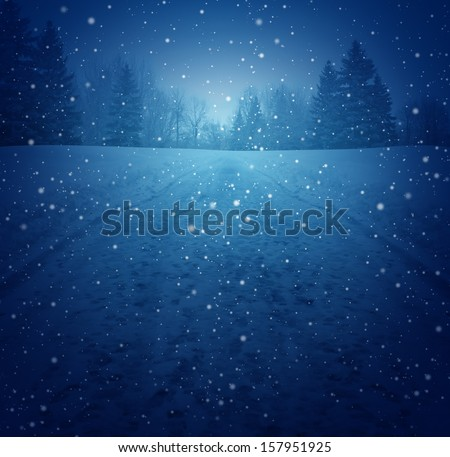 Winter landscape concept as a snowing blue background with a road in perspective with foot prints leading to a forest of trees as a festive seasonal icon of a tranquil and traditional holiday scene. - stock photo