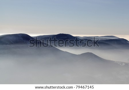 Winter landscape covered by fog in Beskydy - stock photo