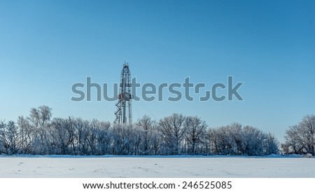 Winter landscape. Drilling rig for the snow-covered forest - stock photo