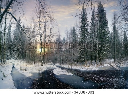 winter landscape frozen creek in the forest - stock photo