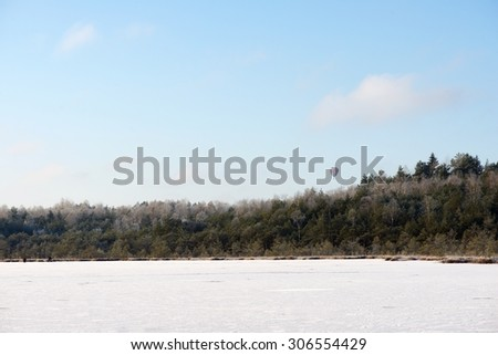 Winter landscape, Frozen lake in winter time and ballon crossing the forest, winter background, lake with ice, frozen background, ice, frozen, winter. Winter time in Lithuania - stock photo