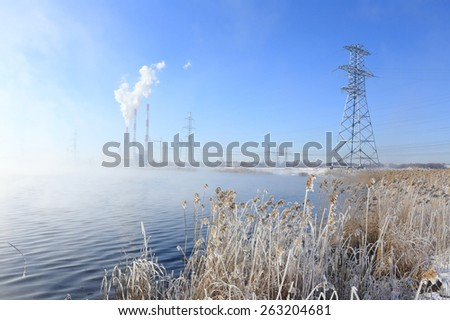 winter landscape Hydroelectric in dense fog early in the morning at sunrise  - stock photo