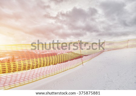 winter landscape in the mountains, ski slope