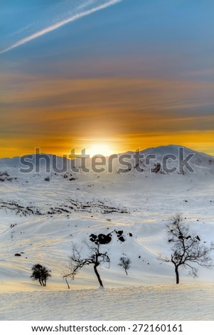 Winter landscape in the Norwegian mountains at sunrise