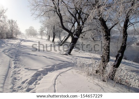 winter landscape misty morning on the river Zai - stock photo