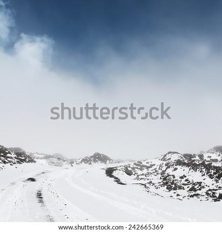 winter landscape near volcano  - stock photo