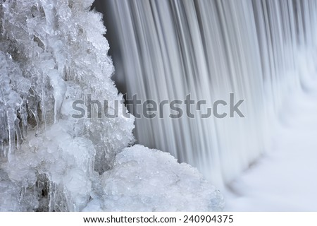 Winter landscape of a cascade on Bear Creek, captured with motion blur, Rocky Mountains, Colorado, USA - stock photo