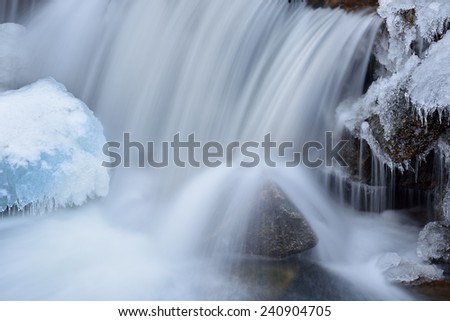 Winter landscape of a cascade on Boulder Creek, captured with motion blur, Rocky Mountains, Colorado, USA - stock photo