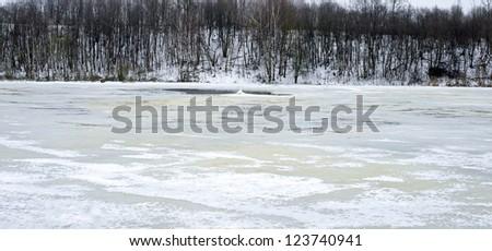 winter landscape of a frozen lake - stock photo