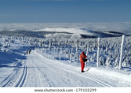 Winter landscape of Jeseniky mountains with the upper reservoir of pumped storage power plant Dlouhe Strane, Czech Republic in the background. - stock photo