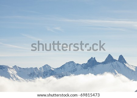Winter landscape of mountains with blue cloudy sky, Saint Jean d'Arves, France - stock photo