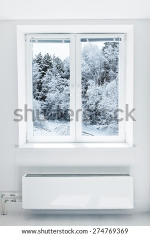 Winter landscape seen through the window - stock photo