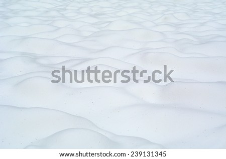 Winter landscape: snow surface with hills under sunlight - stock photo