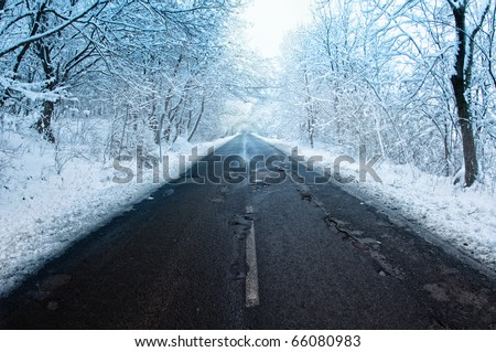 winter landscape. Winter road and trees covered with snow - stock photo