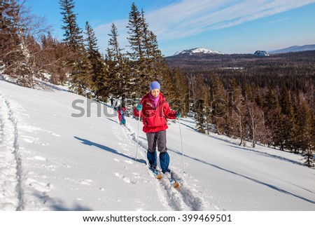 Winter landscape with a mountain ski tracks and tourist back country skier - stock photo