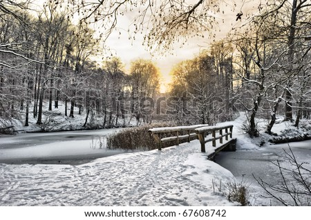 Winter landscape with a wooden bridge - stock photo