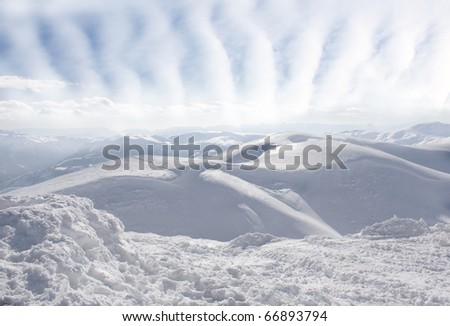 winter landscape with beautiful clouds - stock photo