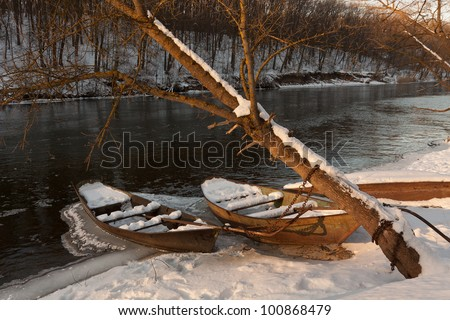 Winter Landscape with boats before sunset