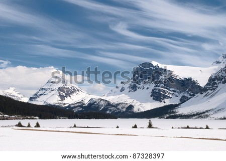 Winter landscape with Canadian Rockies and Bow Lake, Banff National Park, Alberta, Canada - stock photo