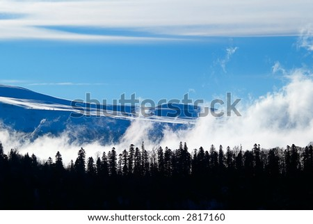 winter landscape with clouds - stock photo