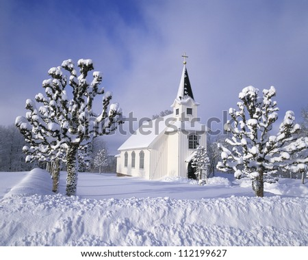 Winter landscape with countryside church