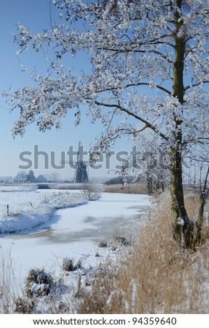 Winter Landscape with Dutch Windmill, Zwartenberg, Etten-Leur, Holland - stock photo