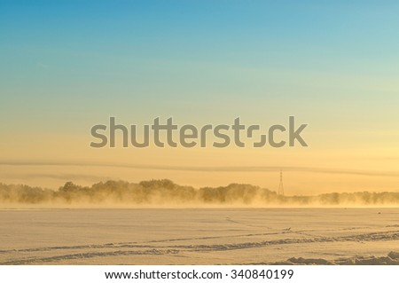 Winter landscape with fog at the sunset - focus at the foreground - stock photo