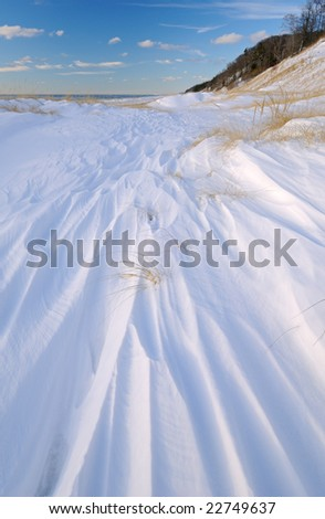 Winter landscape with fresh drifted snow, Saugatuck Dunes State Park, Lake Michigan, Michigan, USA - stock photo