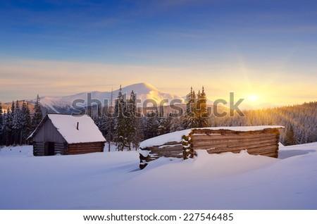 Winter landscape with hut. Sunrise in the mountains. Carpathians, Ukraine, Europe - stock photo