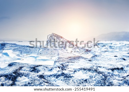 Winter landscape with ice on the lake. Small depth of field. Creative toning effect - stock photo