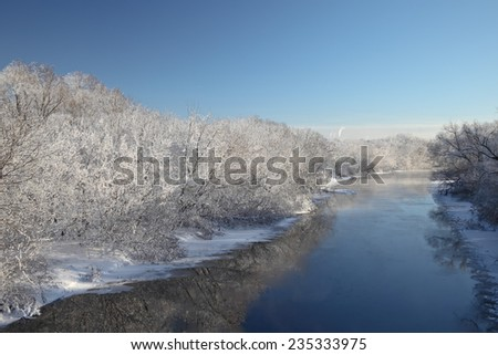 Winter landscape with icy river and winter trees covered with frost. Beautiful winter Christmas background.  - stock photo
