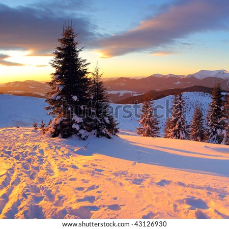 winter landscape with mountains under evening sky with clouds - stock photo